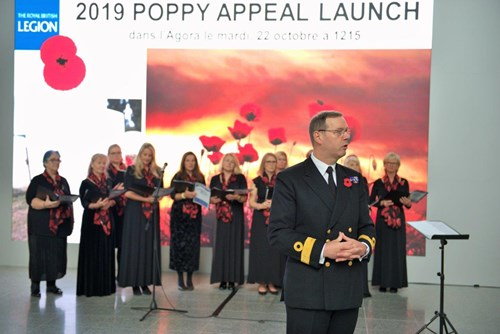 The 2019 Poppy Appeal Launch in Brussels.  Commodore Darren Bone RN addresses the NATO HQ crowds.
